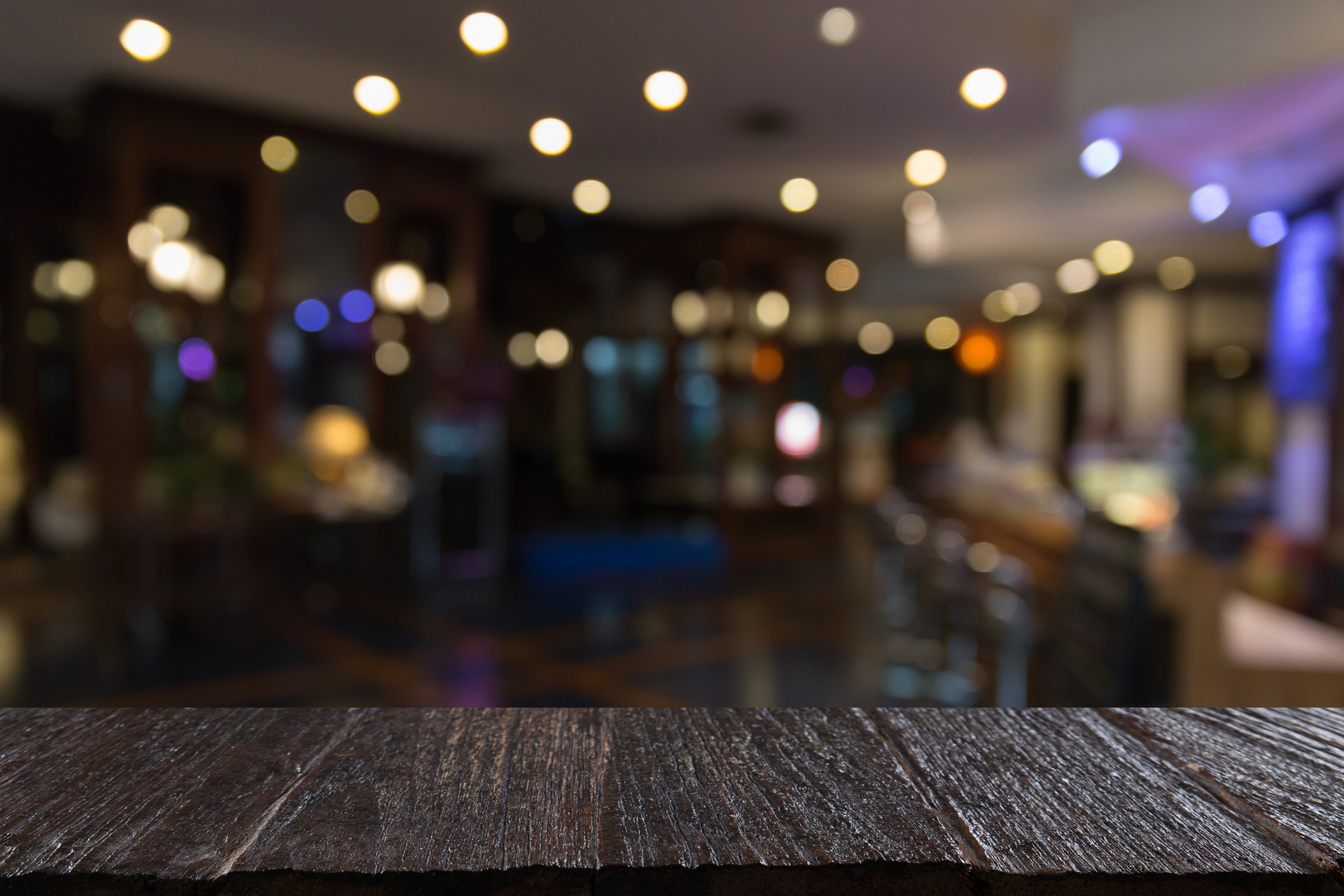 blur background of pub restaurant with wood table - PointOS